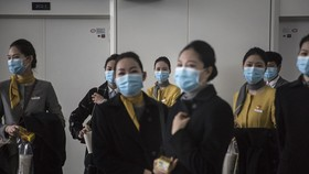 Employees stand during disinfection operations at Wuhan Tianhe International Airport, April 3. Source: Getty Images