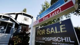 Một bảng hiệu rao bán trước một ngôi nhà ở Vancouver, British Columbia, Canada. Sự quan tâm đến bất động sản ở nước ngoài đang tăng lên trong số những người Trung Quốc giàu có. © Reuters