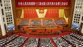 Tại một cuộc họp của Hội nghị Tư vấn Chính trị Nhân dân Trung Quốc tại Bắc Kinh hồi tháng 5, các thành viên đã đề xuất một kế hoạch tạo ra một loại tiền kỹ thuật số Đông Á dựa trên một rổ tiền tệ châu Á. © Kyodo