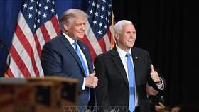 Tổng thống Mỹ Donald Trump (trái) và Phó Tổng thống Mike Pence tại Đại hội toàn quốc của đảng Cộng hòa ở thành phố Charlotte, bang Bắc Carolina, ngày 24/8. Ảnh: AFP/TTXVN