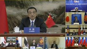 In this screen grab from a video provided by Vietnamese national television VTV, shows Chinese Prime Minister Li Keqiang speaks to ASEAN Plus Three leaders during a virtual summit on Tuesday, Apr.14, 2020.  Credit: VTV via AP