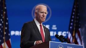 Ông Joe Biden họp báo sau cuộc gặp trực tuyến với ban chấp hành Hiệp Hội các Thống Đốc Quốc Gia vào tháng 11. Ảnh: AFP - JOE RAEDLE