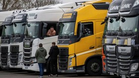 Lorry drivers at the Ashford International Truck Stop in Kent on Tuesday. Thousands of trucks are stuck on the English side of the Channel © Chris J Ratcliffe/Getty
