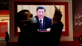 A screen showing Xi Jinping at an installation in Wuhan designed to extol the Chinese government's handling of the coronavirus pandemic. The exhibition does not mention any of the Communist party's failings © REUTERS