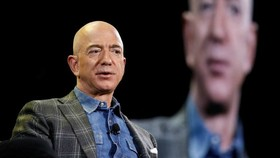 Jeff Bezos, who founded Amazon in 1994, wrote in a letter to staff: 'I've never had more energy, and this isn't about retiring' © AP