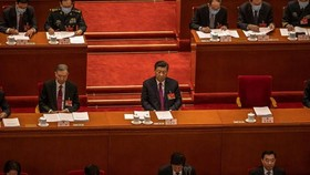 Chinese president Xi Jinping, centre. at a session of the National People's Congress © EPA-EFE