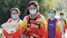 Học sinh Trung Quốc phải đối mặt với sự cạnh tranh gay gắt ngay từ khi còn nhỏ, khiến nhiều phụ huynh phải trả thêm tiền cho việc học thêm. (Ảnh tập tin: AFP)
