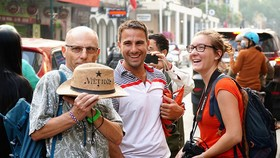 A group of French tourists visit the capital of Hanoi in February, 2019. Photo by VnExpress/Phong Vinh