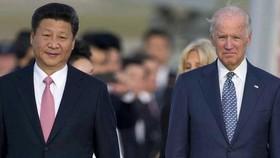 Tổng thống Mỹ Joe Biden (phải) và Chủ tịch Trung Quốc Tập Cận Bình. Ảnh: Xinhua
