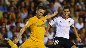 Giờ đây với Ignacio Camacho (trái), màu áo của Malaga đã thuộc về quá khứ .