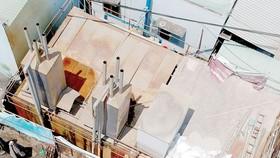 Khai thác nước ngầm tại xã Qui Đức, huyện Bình Chánh, TPHCM  Ảnh: THÀNH TRÍ
