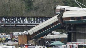 The scene of a portion of the Interstate I-5 highway after an Amtrak high speed train derailled from an overpass early Monday near the city of Tacoma, Washington state