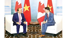 Thủ tướngNguyễn Xuân Phúchội đàm với Thủ tướng Canada Justin Trudeau. Ảnh: TTXVN