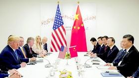 Tổng thống Mỹ Donald Trump gặp Chủ tịch Trung Quốc Tập Cận Bình bên lề Hội nghị Thượng đỉnh Nhóm các nền kinh tế phát triển và mới nổi hàng đầu thế giới tại Nhật Bản tháng 6-2019