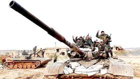 Quân đội Chính phủ Syria đẩy mạnh chiến dịch tấn công bất chấp đe dọa của Thổ Nhĩ Kỳ. Ảnh: AP