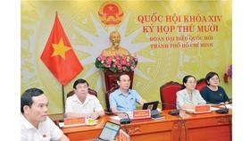 Bí thư Thành ủy TPHCM Nguyễn Văn Nên cùng các đồng chí lãnh đạo thành phố dự kỳ họp Quốc hội ở điểm cầu TPHCM. Ảnh: VIỆT DŨNG