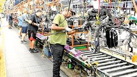 Các doanh nghiệp sản xuất ô tô của Mỹ dần phục hồi. Ảnh: Reuters