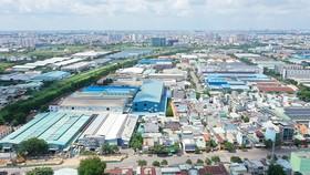 Xung quanh khu công nghiệp Tân Bình đã mọc lên nhiều khu dân cư. Ảnh: HOÀNG HÙNG