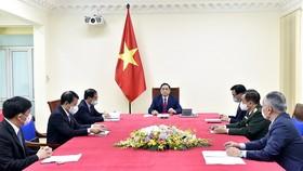 Thủ tướng Chính phủ Phạm Minh Chính điện đàm với Thủ tướng Quốc vụ viện nước Cộng hòa nhân dân Trung Hoa Lý Khắc Cường. Ảnh: TTXVN