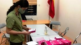 Lực lượng quản lý thị trường Hà Nội thu giữ lượng lớn kit test nhanh Covid-19 không rõ nguồn gốc