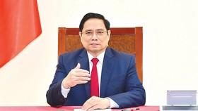 Thủ tướng Phạm Minh Chính điện đàm với Tổng Giám đốc WHO Tedros Adhanom Ghebreyesus. Ảnh: Chinhphu.vn