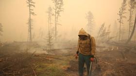 Sau trận hỏa hoạn ở Yakutia, Nga ngày 17-7.  Ảnh: Reuters
