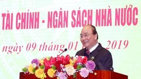 Thủ tướng Chính phủ tại hội nghị tổng kết ngành tài chính chiều 9/1. (Ảnh: CTV/Vietnam+)
