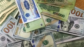 NHNN tiếp tục điều chỉnh tăng tỷ giá trung tâm