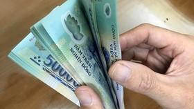 Chưa điều chỉnh tiền lương cơ sở và chuẩn nghèo trong năm 2021