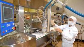 Công nghệ sản xuất tiên tiến giúp giảm khí thải  (ảnh chụp tại Công ty Kido trong KCN Tây Bắc, Củ Chi). Ảnh: CAO THĂNG
