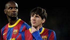 Eric Abidal và Lionel Messi