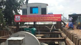 Hệ thống máy bơm sẵn sàng bơm chống ngập đường Nguyễn Hữu Cảnh. Ảnh: QUỐC HÙNG
