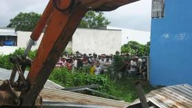Cưỡng chế vi phạm xây dựng tại huyện Bình Chánh.