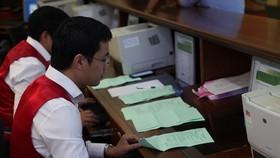 Tháng 10, toàn bộ khối lượng trái phiếu gọi thầu được phát hành với tỷ lệ trúng thầu 99,7%, giá trị tương ứng 20.190 tỷ đồng. (Anh: HNX/Vietnam+)