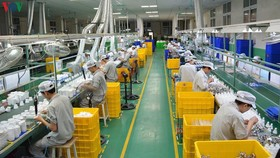 Nhiều doanh nghiệp phải thu hẹp sản xuất vì Covid-19. (Ảnh minh họa)