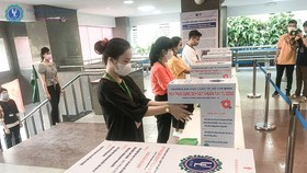 Trường ĐH Luật TP.HCM thực hiện trở lại các biện pháp phòng chống dịch COVID-19 tại trường - Ảnh: THÀNH AN
