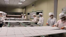 Sản xuất tại Công ty TNHH Green Energy Technology Việt Nam, trong khu công nghiệp VSip, Hoàn Sơn, huyện Tiên Du, tỉnh Bắc Ninh. (Ảnh: Thanh Thương/TTXVN)