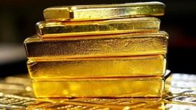 """Chỉ trong vòng 5 ngày, giá vàng thế giới đã """"bốc hơi"""" 100 USD, tương đương hơn 2 triệu đồng/lượng. (Ảnh minh họa: KT)"""