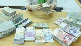 Mục tiêu điều hành xuyên suốt của chính sách tiền tệ nói chung và chính sách tỷ giá nói riêng là kiểm soát lạm phát và giữ ổn định kinh tế vĩ mô (Ảnh minh họa: KT)