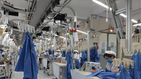 Dịch bệnh Covid-19 đã tác động nặng nề đến hoạt động sản xuất kinh doanh của doanh nghiệp (Ảnh minh họa: KT)