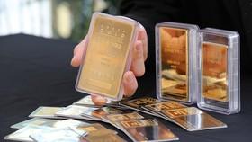 Vàng miếng tại sàn giao dịch vàng ở Seoul, Hàn Quốc. (Ảnh: Yonhap/TTXVN)