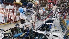Công ty cổ phần càphê hòa tan Trung Nguyên tại Bắc Giang hiện đang xuất khẩu sang nhiều nước như: Trung Quốc, Nga, Singapore…đã có kế hoạch đầu tư thêm nhiều dây chuyền mới trong đầu năm 2021. (Ảnh: Danh Lam - TTXVN)