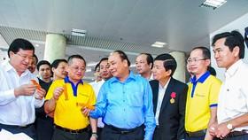 Thủ tướng Nguyễn Xuân Phúc trong chuyến về thăm Tập đoàn thủy sản Minh Phú.