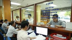 Hoạt động tại Cục Thuế Hà Nội. (Ảnh: TTXVN phát)