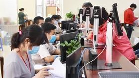 Giải quyết hồ sơ thủ tục hành chính cho người dân, doanh nghiệp tại Sở Tư pháp TP Hồ Chí Minh. (Nguồn: hcmcpv.org.vn)