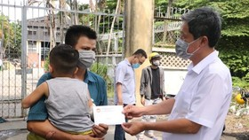 Thăm hỏi gia đình nạn nhân vụ cháy ở quận Tân Phú