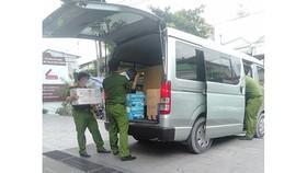Lực lượng công an khám xét, thu giữ nhiều tài liệu liên quan vụ án