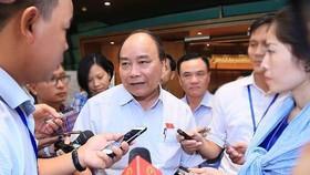 Thủ tướng Nguyễn Xuân Phúc trao đổi với báo chí sáng 7-6-2018.