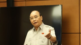 Chủ tịch nước Nguyễn Xuân Phúc phát biểu tại phiên họp tổ. Ảnh: QUANG PHÚC
