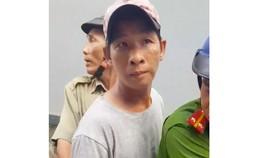 Việt lúc bị đưa về trụ sở